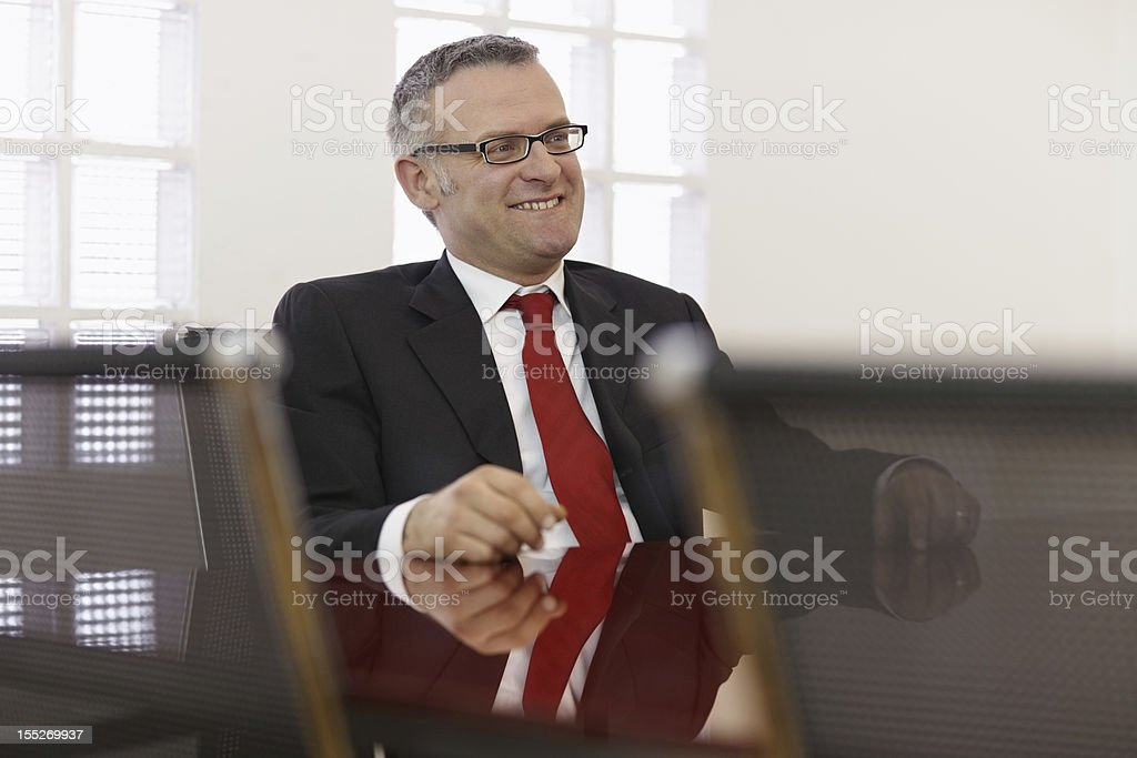Businessman in corporate meeting royalty-free stock photo