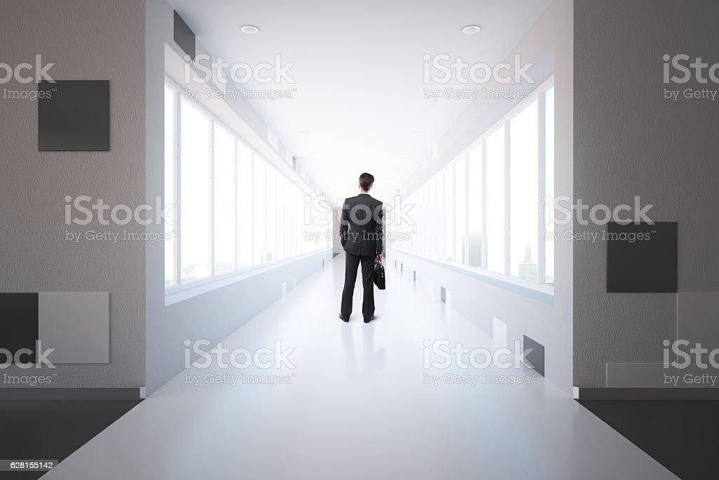 Businessman in corridor stock photo