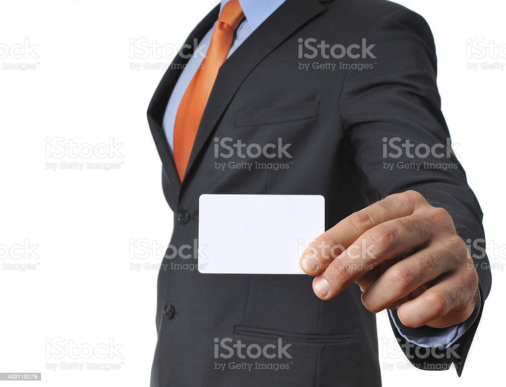 Businessman in dark suit with necktie showing blank business card royalty-free stock photo