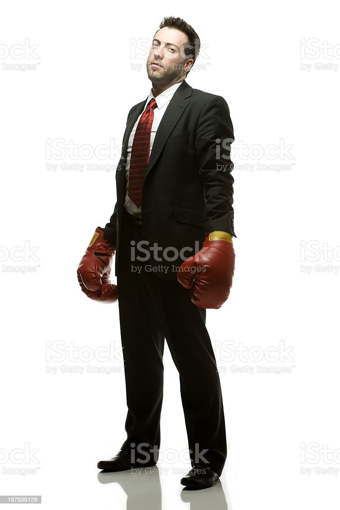Businessman in dark suit with red Boxing gloves.. royalty-free stock photo