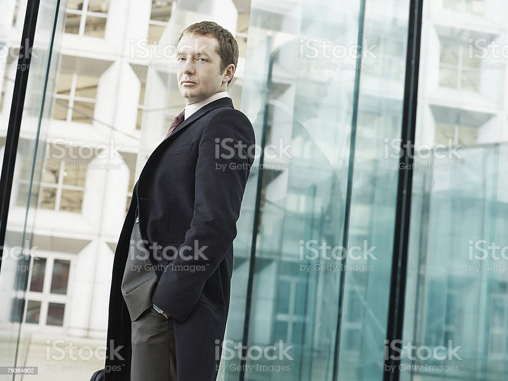 Businessman in doorway holding briefcase royalty-free stock photo
