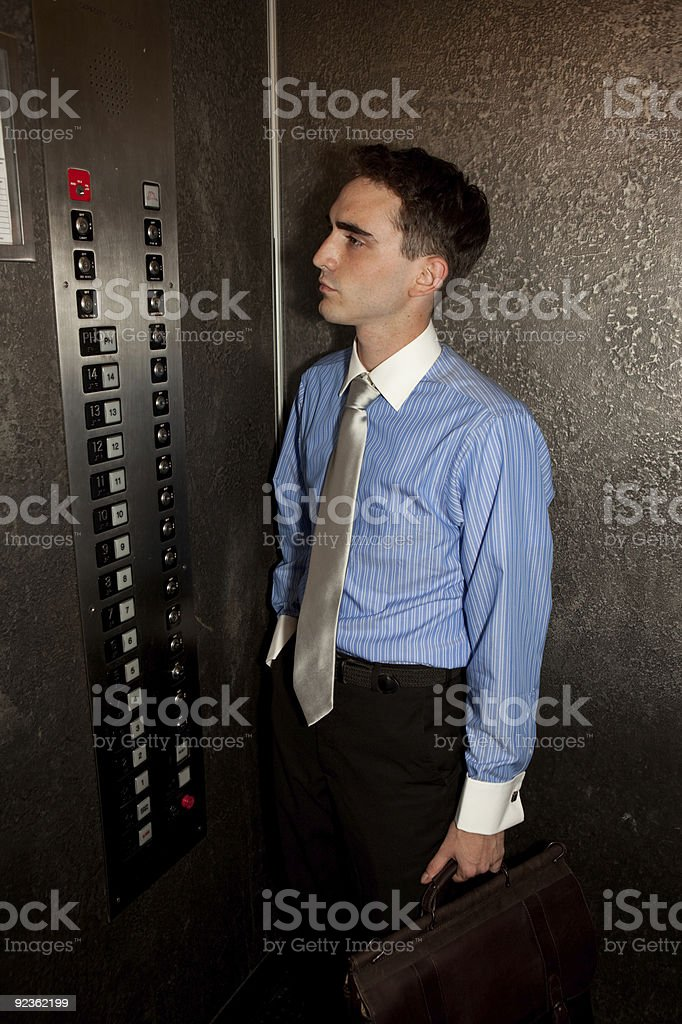 Businessman in Elevator royalty-free stock photo
