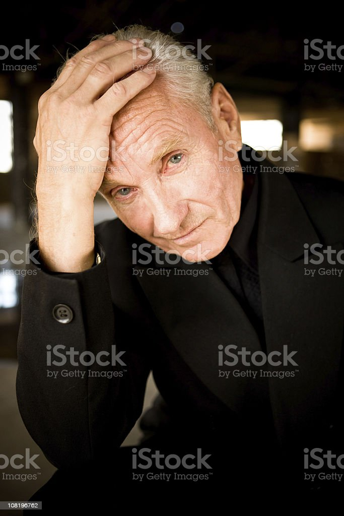 Businessman in empty warehouse royalty-free stock photo