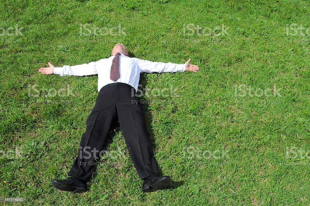 businessman in fallback position stock photo