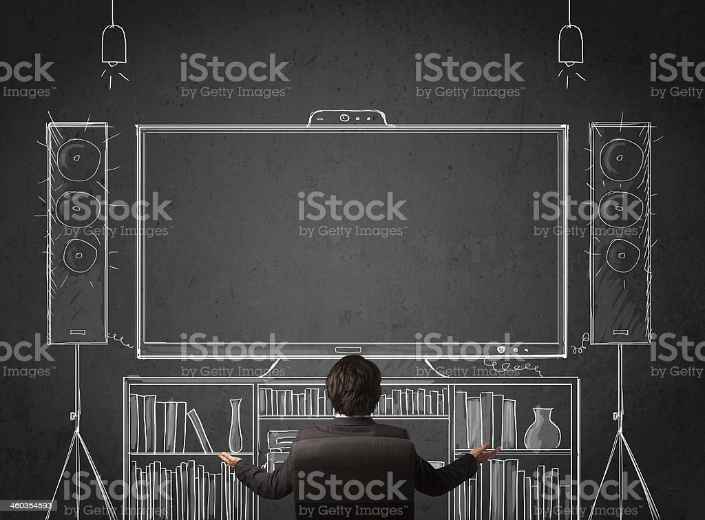 Businessman in front of a home cinema system stock photo