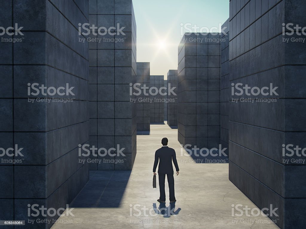 Businessman in front of a huge maze.3D rendering. stock photo