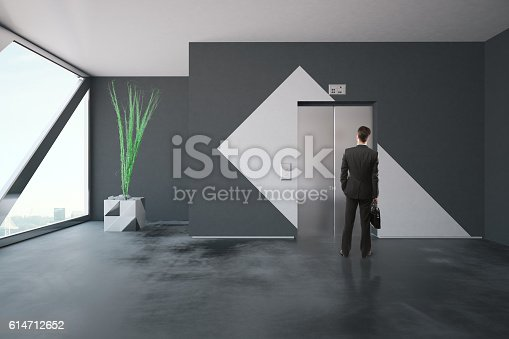 638591126 istock photo Businessman in front of elevator 614712652