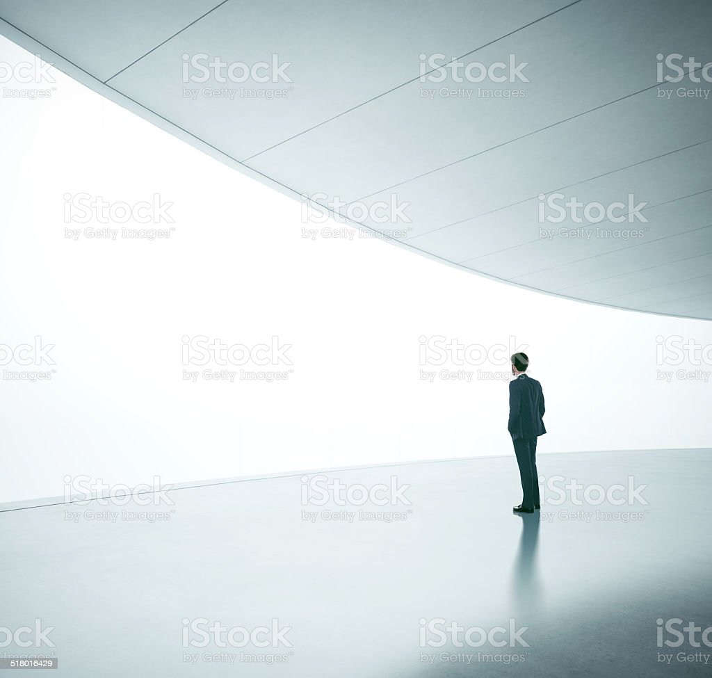 Businessman in front of screen stock photo