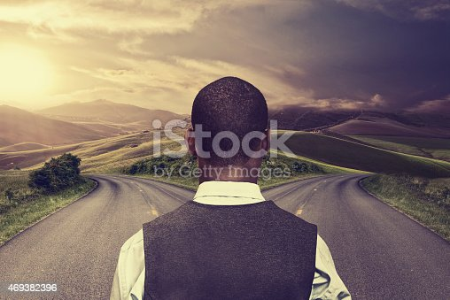 istock businessman in front of two roads 469382396