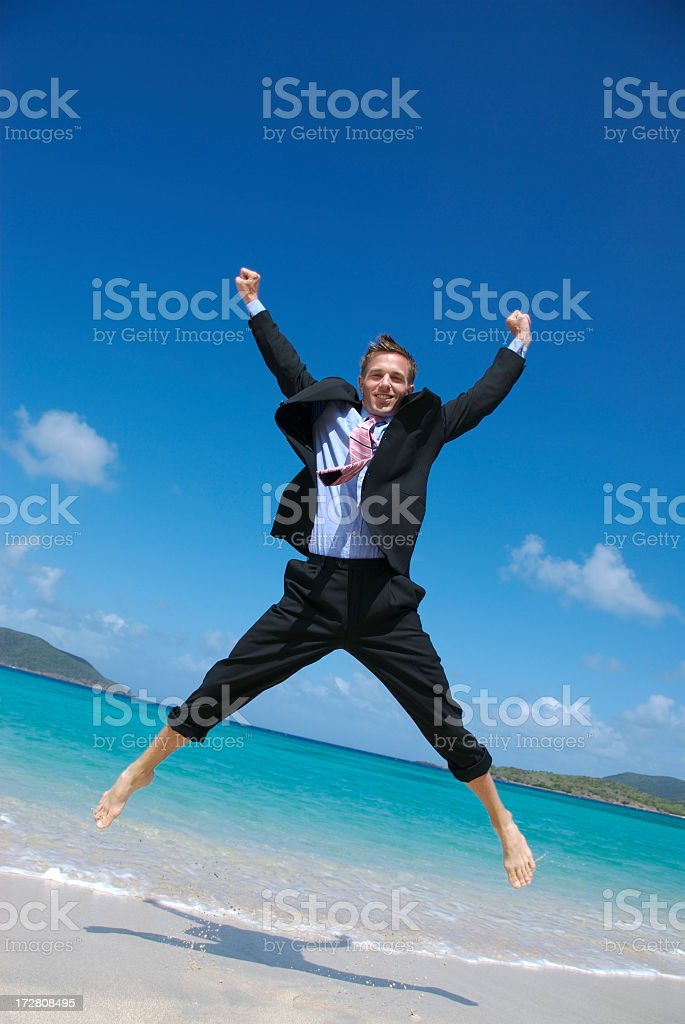 Businessman in Full Suit Does Happy Spreadeagle Jump Tropical Beach stock photo