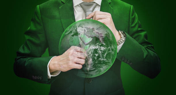 Businessman in green suit holding necktie with green globe, on green background. Element of this image are furnished by NASA Businessman in green suit holding necktie with green globe, on green background. Element of this image are furnished by NASA (https://svs.gsfc.nasa.gov/11650) augmented reality sustainable stock pictures, royalty-free photos & images