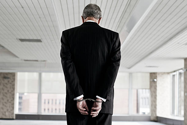 Businessman in handcuffs  crime stock pictures, royalty-free photos & images