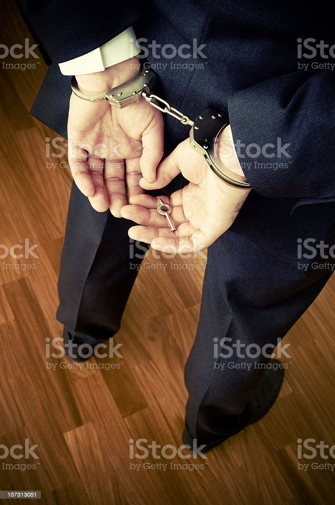 Businessman in Handcuffs royalty-free stock photo