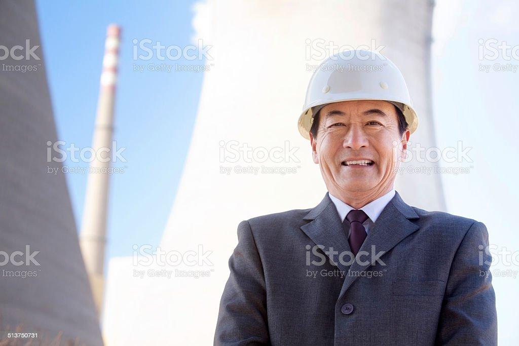 Businessman in Hardhat stock photo