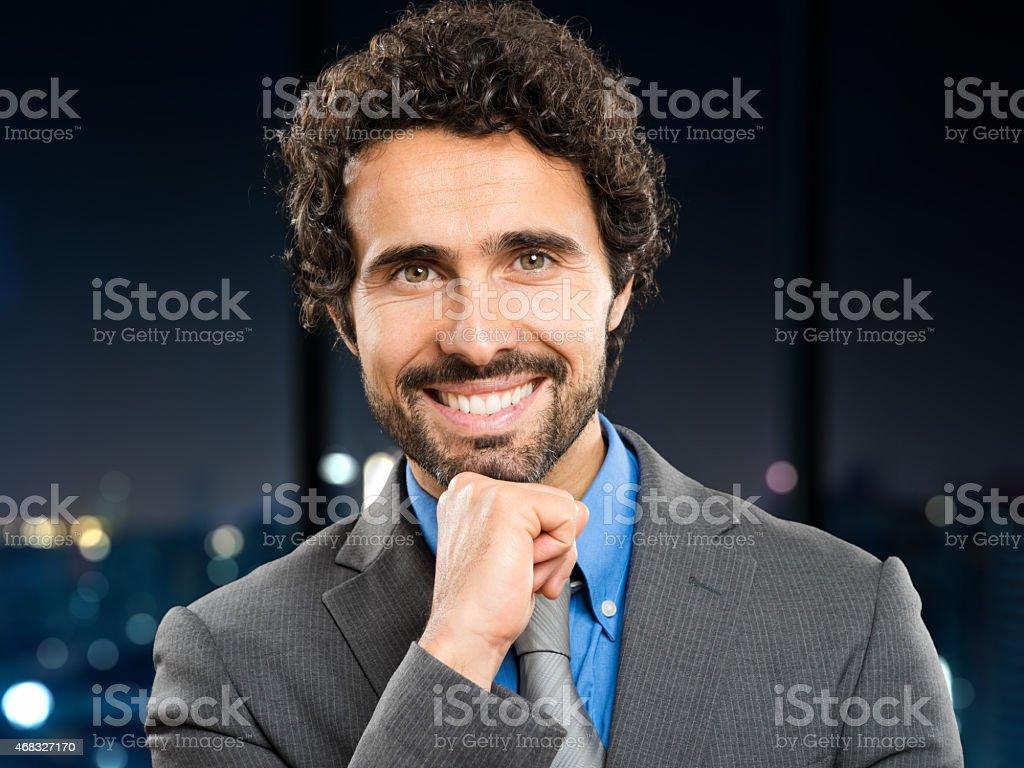 Businessman in his studio at night stock photo
