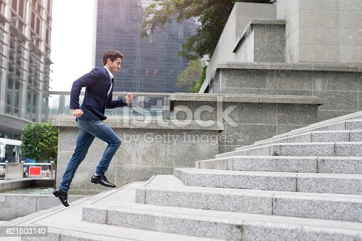 istock Businessman in hurry 621503140