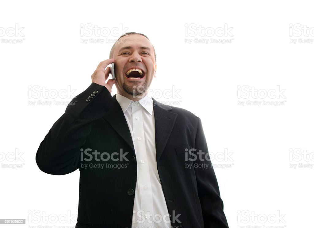 businessman in jacket laughing and talking on the phone foto royalty-free