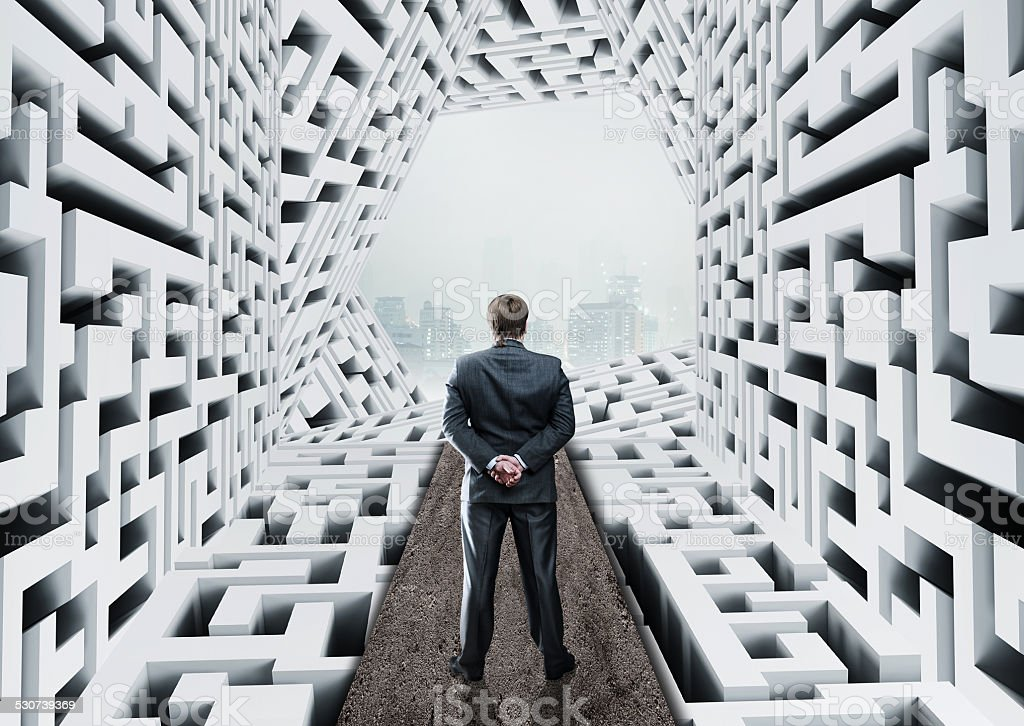 Businessman in labyrinth stock photo