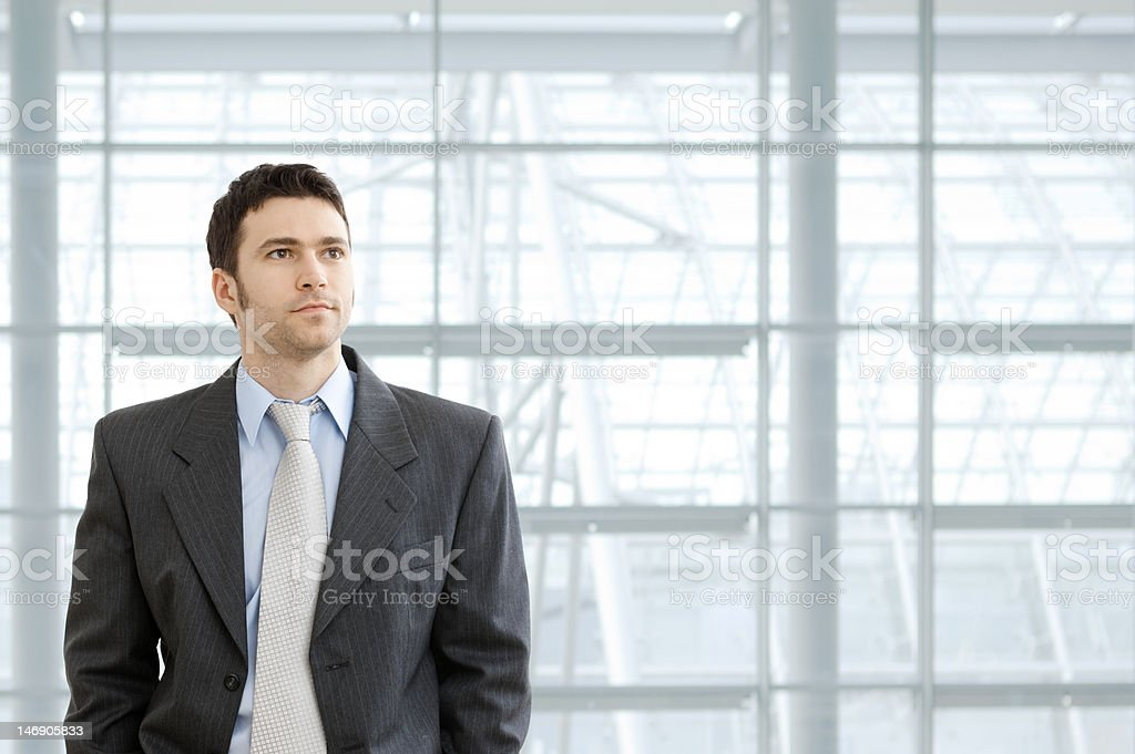 Businessman in lobby royalty-free stock photo