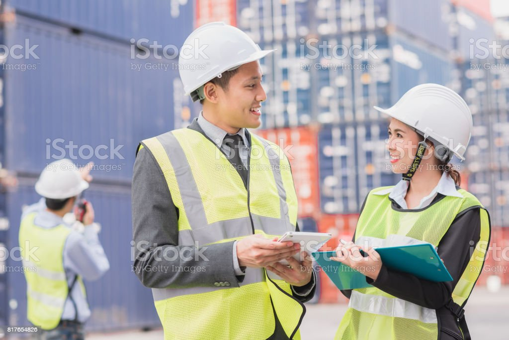 businessman in logistic, export, import industry with shipping cargo container freight in background. stock photo