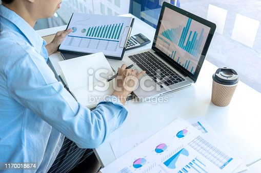 687687166 istock photo businessman in meeting analysis chart graphy 1170018674