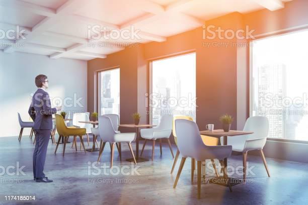 Businessman in minimalistic cafe interior picture id1174185014?b=1&k=6&m=1174185014&s=612x612&h=t7ef56cwpuxuckbzbdefeph4brmmrrgsxp7ddoicxj4=