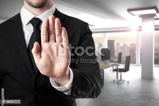 businessman in modern office room hand stop gesture