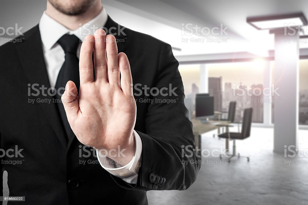 businessman in modern office hand stop gesture stock photo