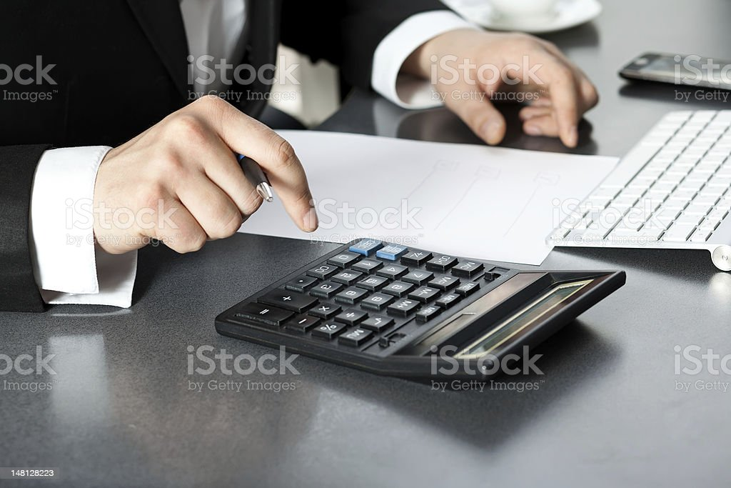 Businessman in office at the computer royalty-free stock photo