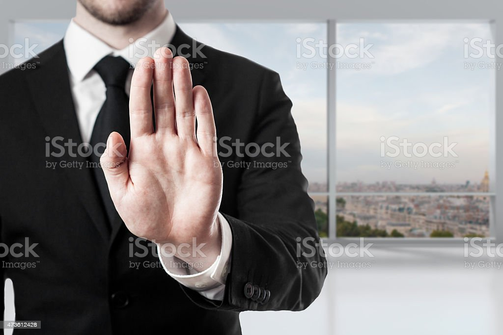 businessman in office hand stop gesture stock photo