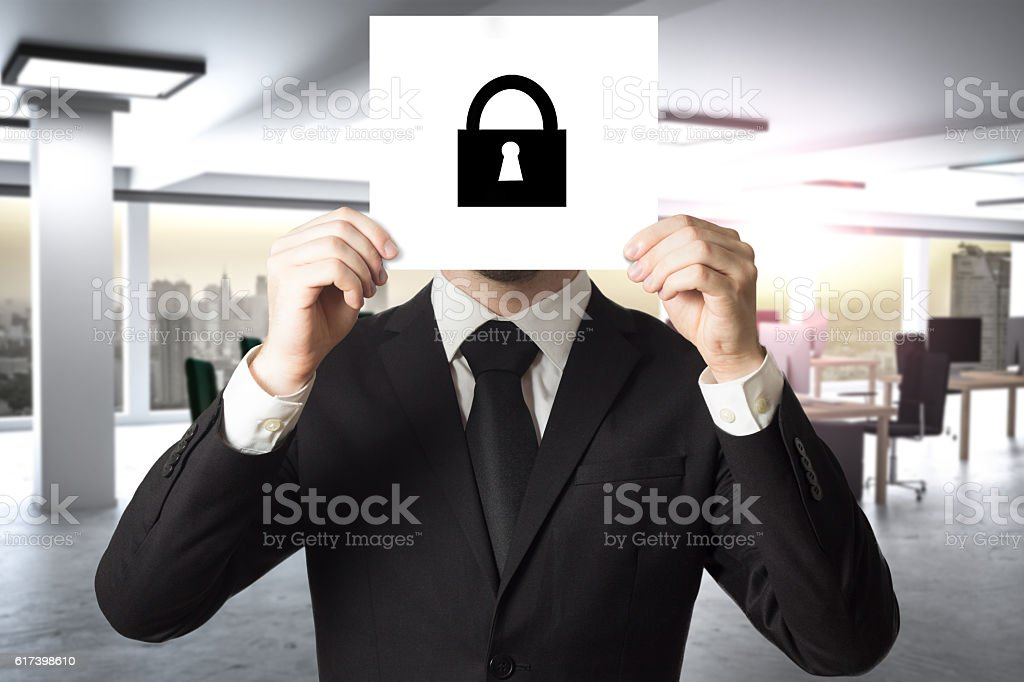 businessman in office hiding face sign lock symbol stock photo