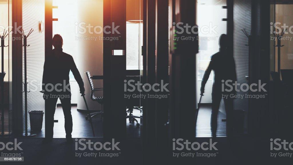 Businessman in office holding katana sword stock photo
