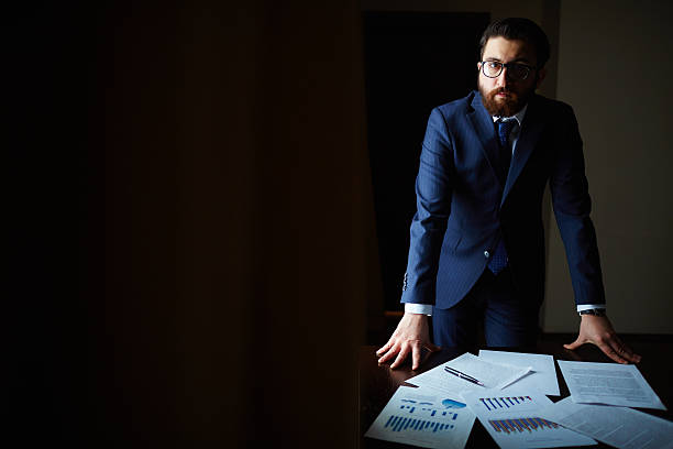 businessman in office - low lighting stock photos and pictures