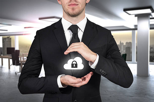 businessman in office protecting internet cloud security with ha stock photo