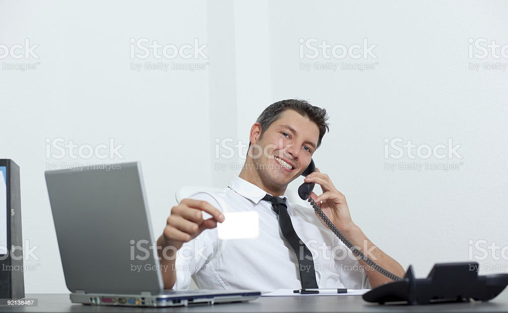 businessman in office with phone and businesscard royalty-free stock photo