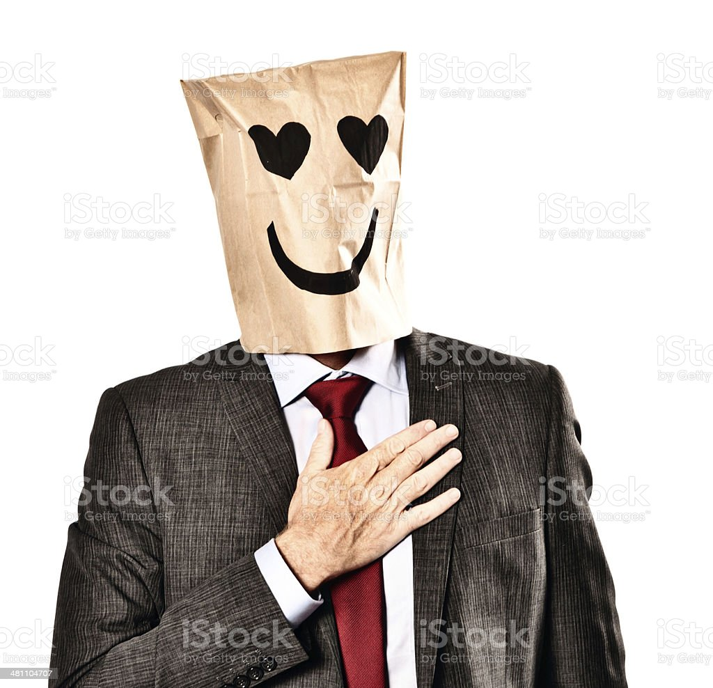 Businessman in paper-bag mask with heart-shaped eyes is lovestruck royalty-free stock photo