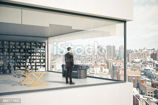 istock Businessman in see-through building 585777600