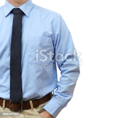 istock businessman in shirt with tie, jeans with hand in pocket 488244183