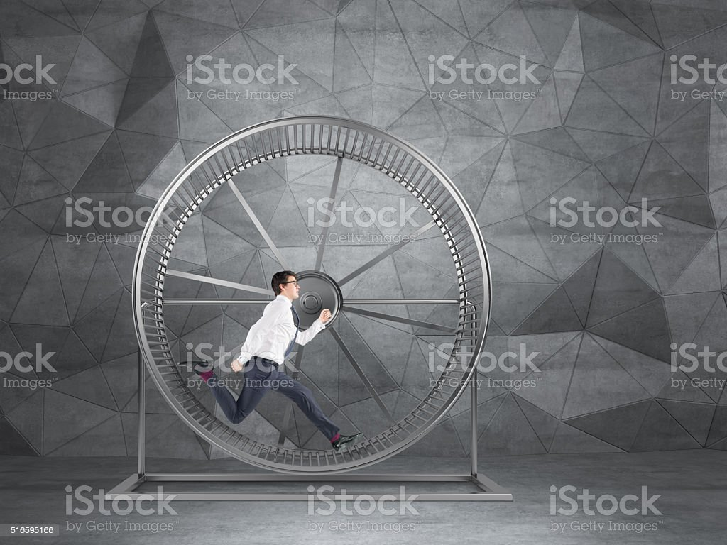 Businessman in spinning wheel stock photo