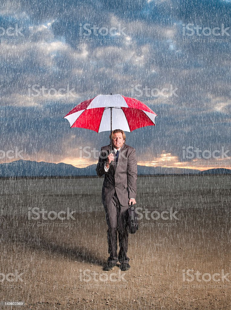 Businessman in Storm stock photo