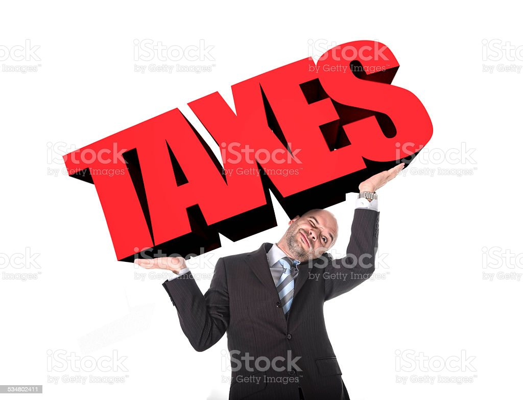 businessman in stress carrying heavy taxes 3d text stock photo