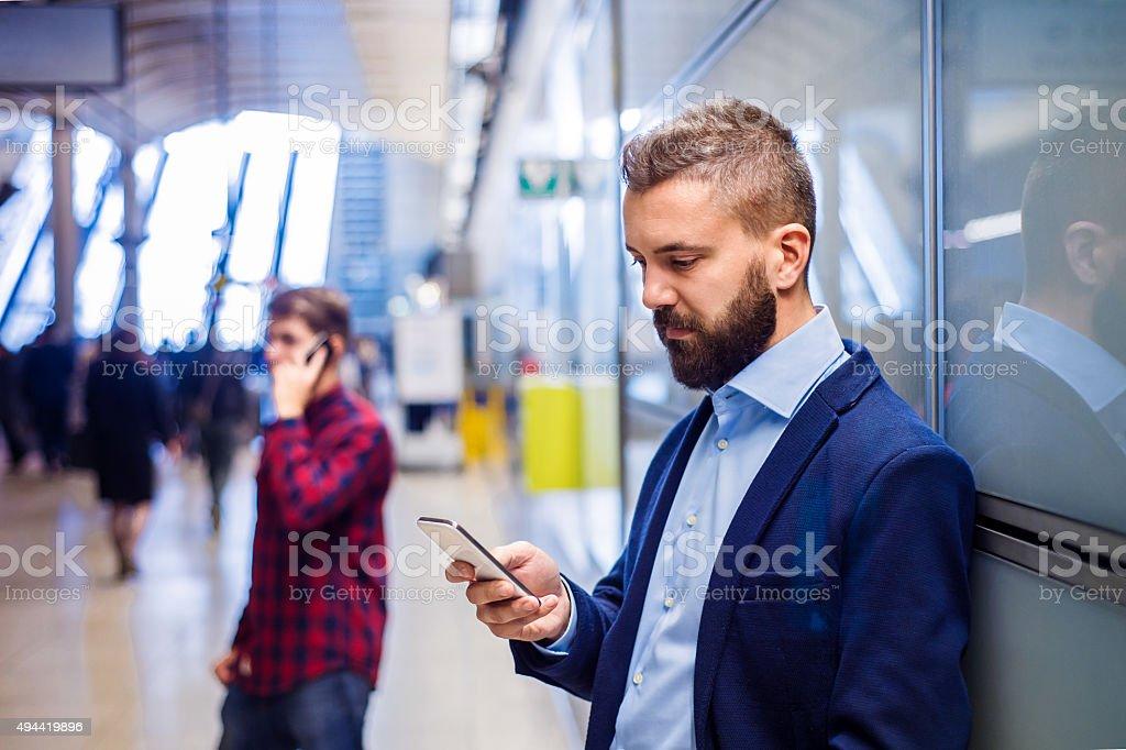 Businessman in subway stock photo