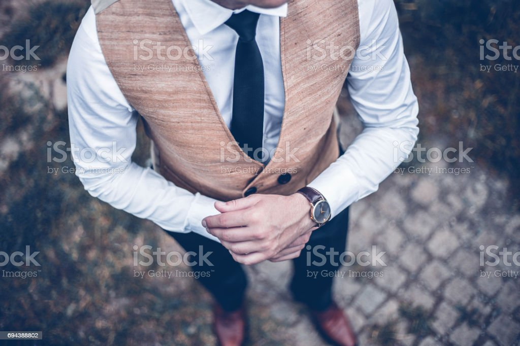 Businessman in suit adjusting watch stock photo