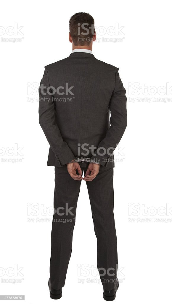 Businessman in suit and handcuffs stock photo