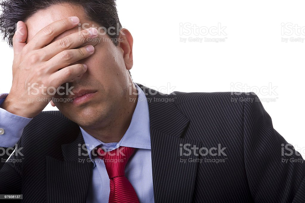 Businessman in suit covers face with hand to calm headache royalty-free stock photo