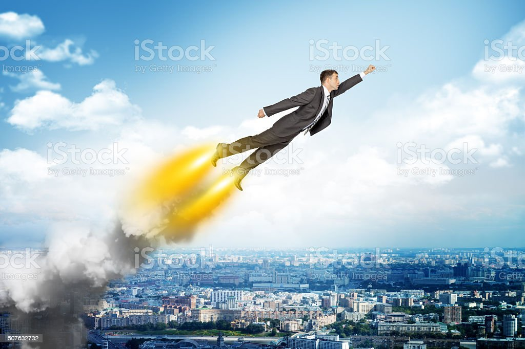 Businessman in suit flying stock photo