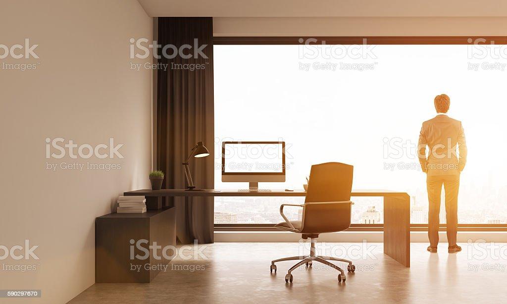 Businessman in suit looking at city from office window royaltyfri bildbanksbilder