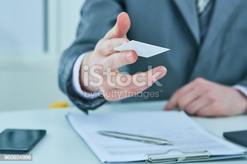 istock Businessman in suit offering plastic credit card. Credit and banking account concept 960604996