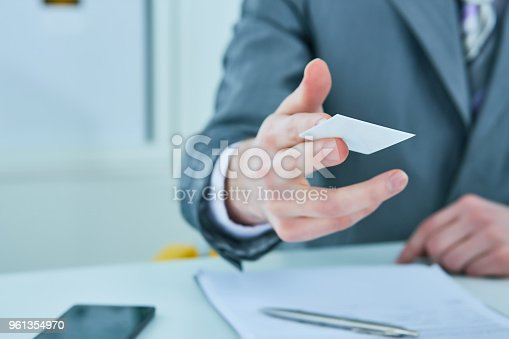istock Businessman in suit offering plastic credit card. Credit and banking account concept 961354970