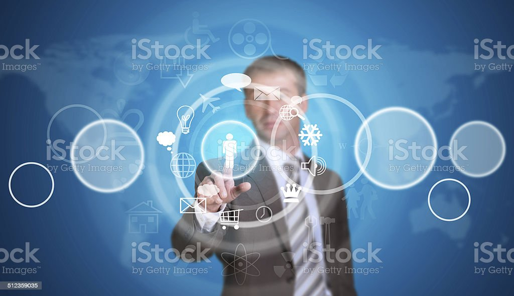 Businessman in suit pointing her finger at cloud icons stock photo